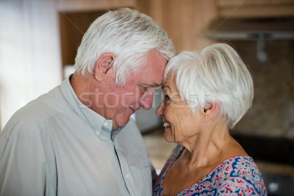 Happy senior couple looking at each other in kitchen Stock photo © wavebreak_media