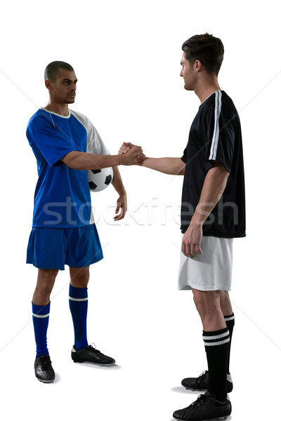 Deux football joueurs serrer la main fitness handshake Photo stock © wavebreak_media