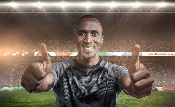 Composite image of portrait of confident athlete smiling and sho Stock photo © wavebreak_media