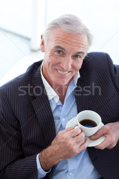 Businessman drinking and sitting in a waiting room Stock photo © wavebreak_media