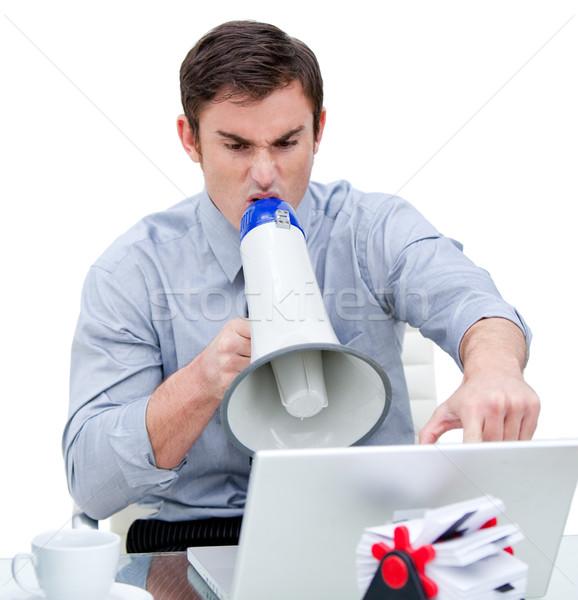 Mérges üzletember kiabál megafon iroda laptop Stock fotó © wavebreak_media