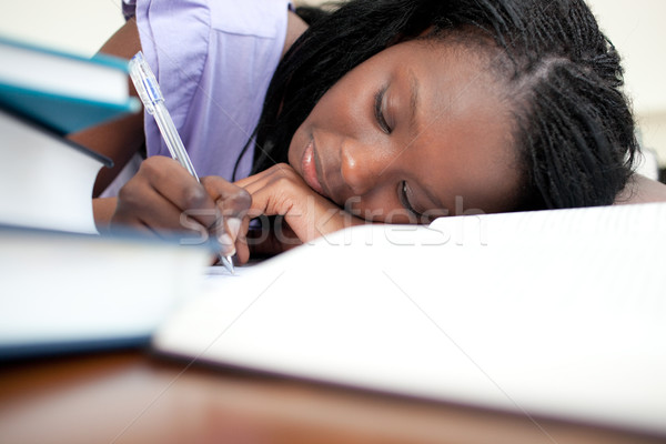 Tired teen girl doing her homework  Stock photo © wavebreak_media