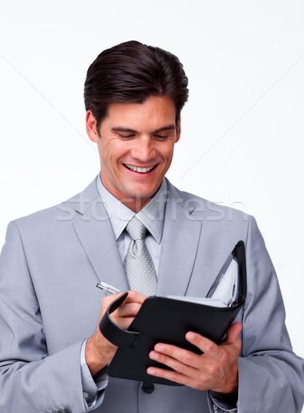 Glimlachend zakenman agenda witte kantoor Stockfoto © wavebreak_media