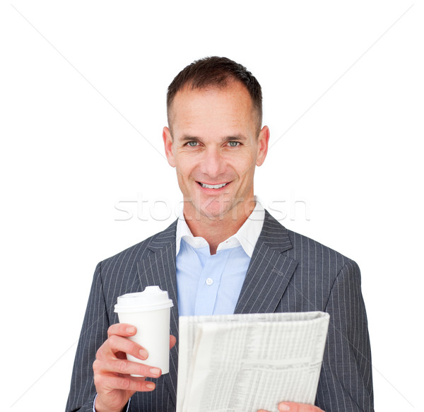Assertive businessman reading a newspaper Stock photo © wavebreak_media
