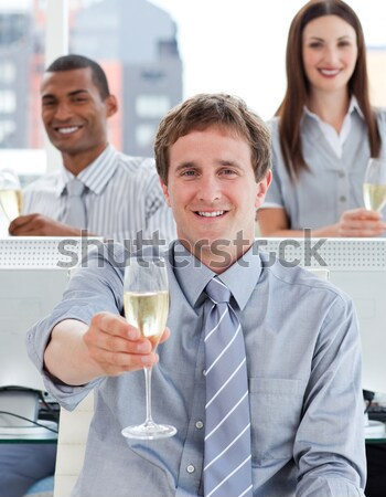 Multi-ethnic business co-workers toasting with Champagne  Stock photo © wavebreak_media