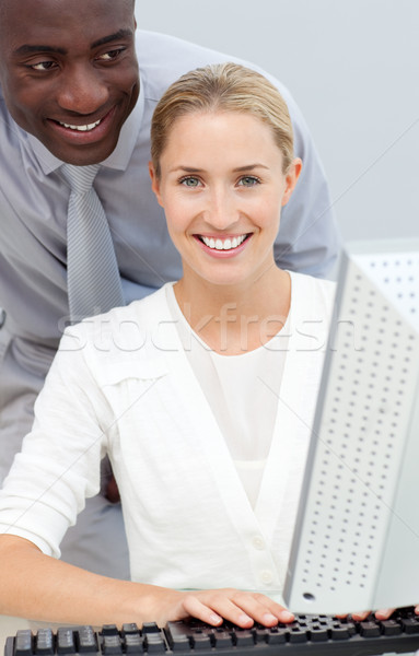 Afro-american businessman and his colleague working at a compute Stock photo © wavebreak_media