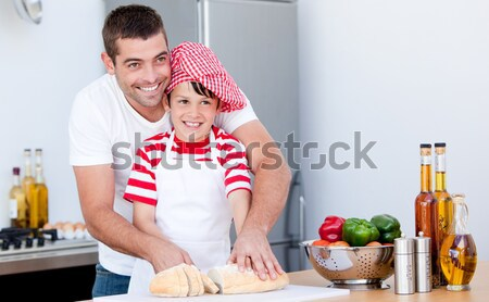 Boy hurt his finger cooking and father treating it Stock photo © wavebreak_media