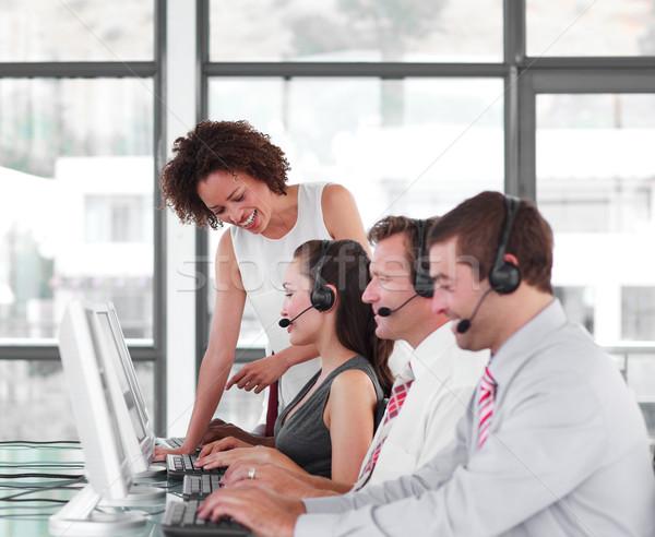 Sorridere femminile leader squadra call center business Foto d'archivio © wavebreak_media