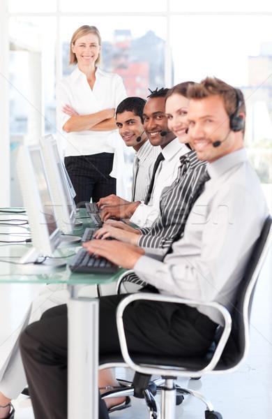 Pretty female leader managingher team in a call center Stock photo © wavebreak_media