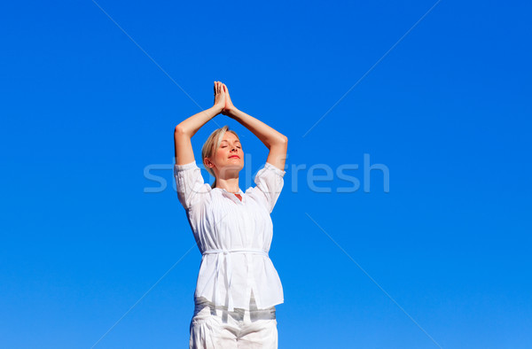 Attractive woman practising yoga  Stock photo © wavebreak_media