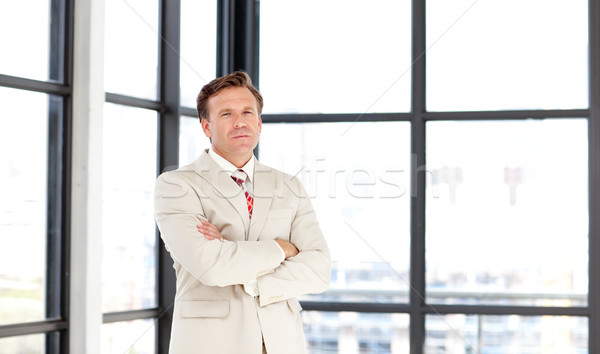 Business leader with folded arms looking at the camera Stock photo © wavebreak_media
