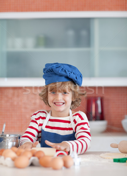 Smiling boy baking at home Stock photo © wavebreak_media