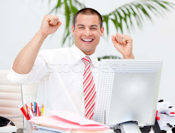 Stock photo: Cheerful businessman punching the air in celebration