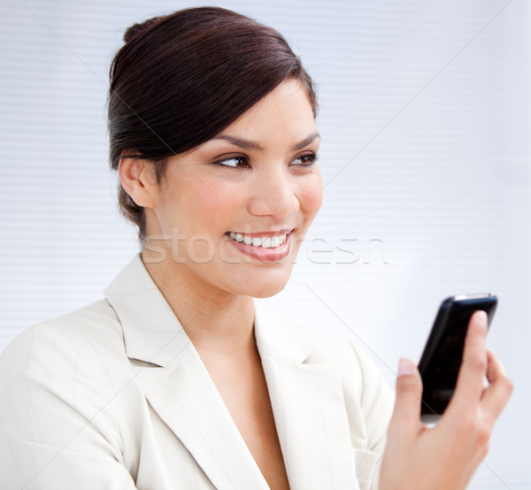 Radiant businesswoman using a mobile phone Stock photo © wavebreak_media