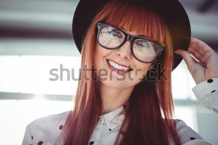 Beautiful businesswoman drinking coffee  Stock photo © wavebreak_media