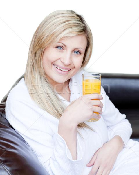 Beautiful woman drinking an orange jus  Stock photo © wavebreak_media