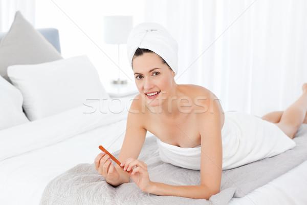 Superb woman filing her nails Stock photo © wavebreak_media