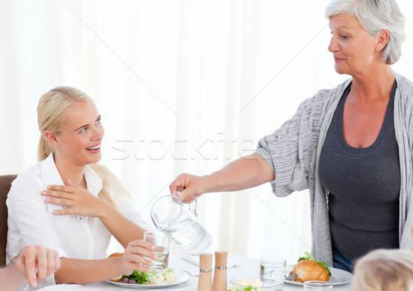 бабушки дочь воды еды продовольствие домой Сток-фото © wavebreak_media