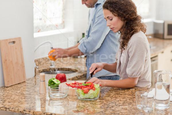Hombre guapo cocina compañera casa sonrisa hombre Foto stock © wavebreak_media