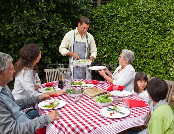Férfi adag család asztal étel gyerekek Stock fotó © wavebreak_media