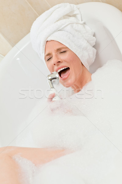 Charming woman taking a bath with a towel on her head  Stock photo © wavebreak_media