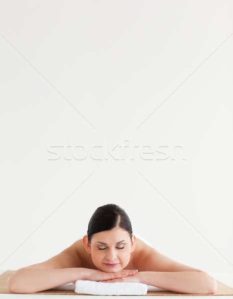 Cute dark-haired woman relaxing in a spa centre Stock photo © wavebreak_media