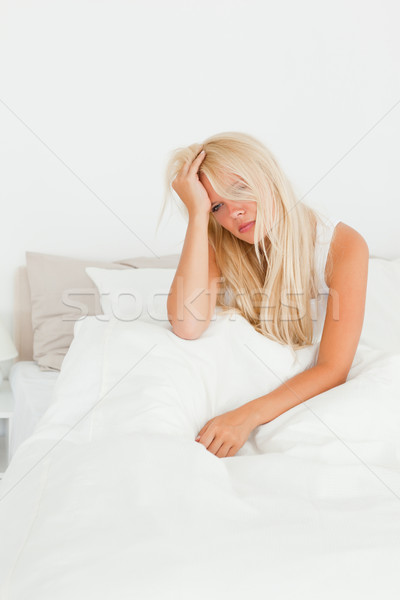 Portrait of a beautiful woman sitting on her bed while waking up Stock photo © wavebreak_media
