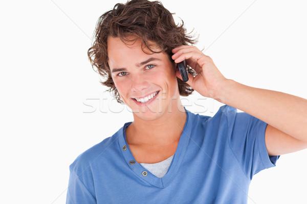 Handsome dark-haired guy on the phone in a studio Stock photo © wavebreak_media