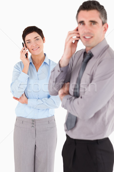 Portrait of a managers making a phone call against a white background Stock photo © wavebreak_media