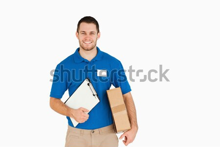 Lächelnd jungen Umsatz Assistent Paket weiß Stock foto © wavebreak_media