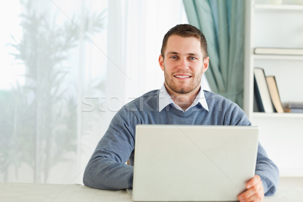 Young man with his notebook in his homeoffice Stock photo © wavebreak_media
