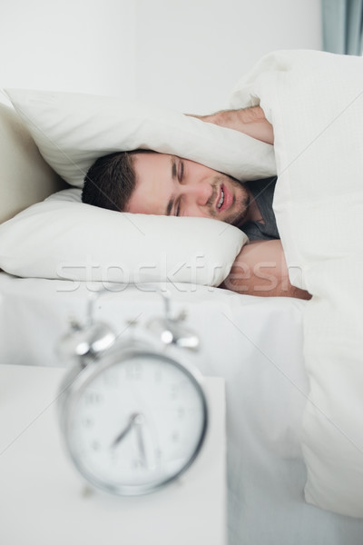 Portré kimerült fiatalember fülek ébresztőóra hálószoba Stock fotó © wavebreak_media