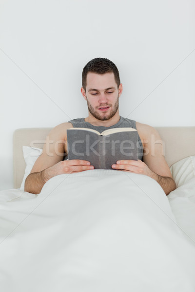 Portrait of a man reading a novel in his bedroom Stock photo © wavebreak_media