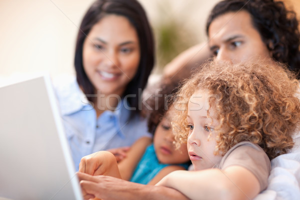Cheerful young family using laptop together Stock photo © wavebreak_media