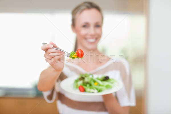 Tomato being offered by smiling woman Stock photo © wavebreak_media