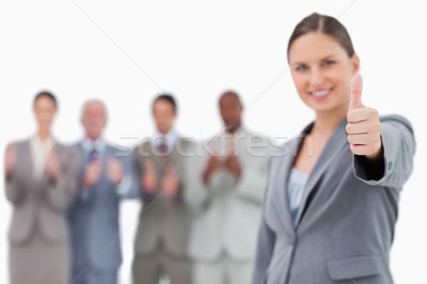 Mosolyog üzletasszony hüvelykujj felfelé kollégák mögött Stock fotó © wavebreak_media