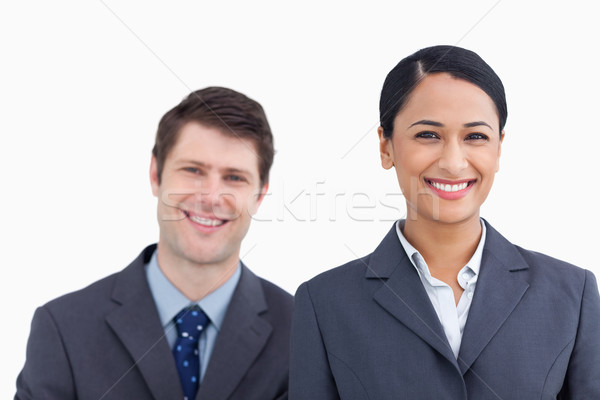 Stock photo: Close up of smiling salesteam against a white background