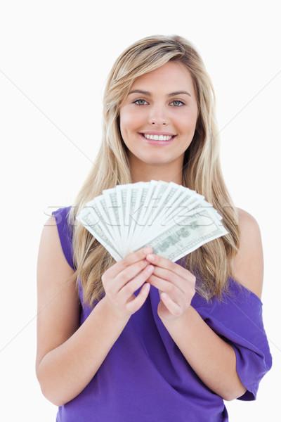 Heureux femme blonde fan note blanche Photo stock © wavebreak_media
