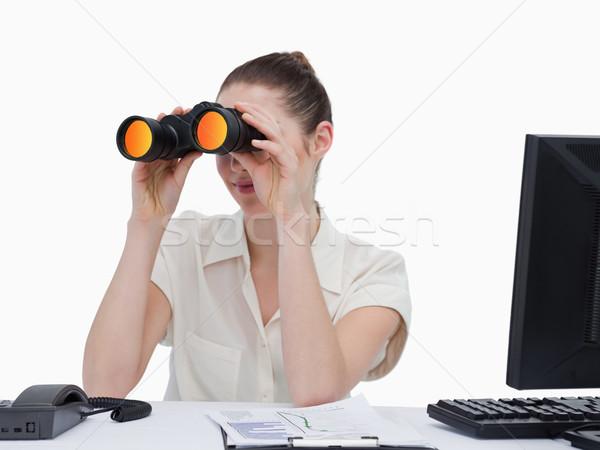 молодые деловая женщина глядя бинокль белый лице Сток-фото © wavebreak_media
