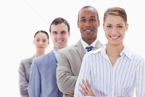 Close-up of a business team smiling in a single line with focus on the first woman Stock photo © wavebreak_media