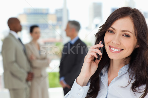 Young smiling executive woman on the cell phone and tilting her head to one side Stock photo © wavebreak_media