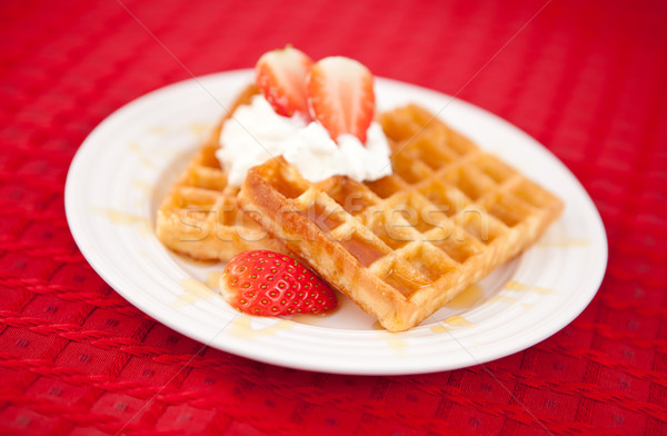 Half cut strawberry and whipped cream on a red tablecloth Stock photo © wavebreak_media