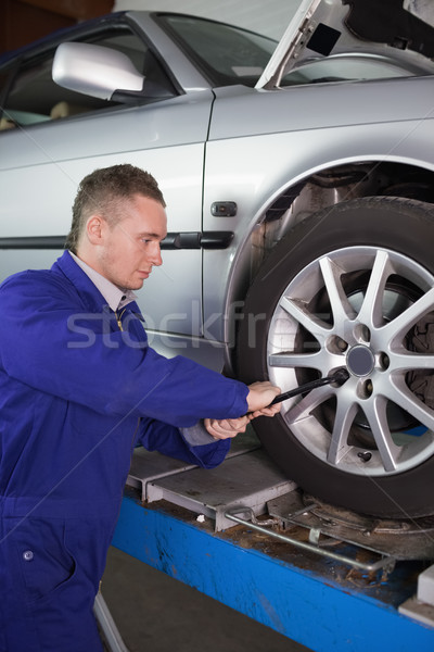 Mechanic unscrewing a bolt with a wrench in a garage Stock photo © wavebreak_media