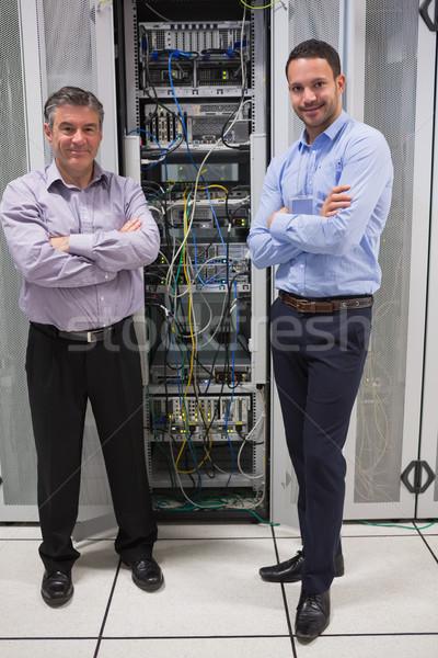 Two technicians standing in front of servers in data center Stock photo © wavebreak_media