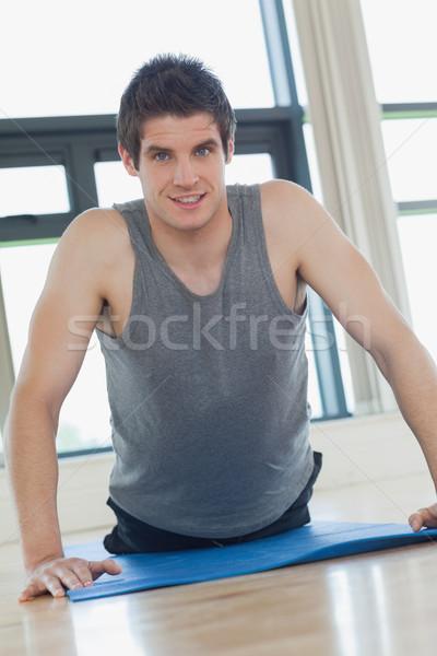Man doing push ups on the floor at the gym Stock photo © wavebreak_media