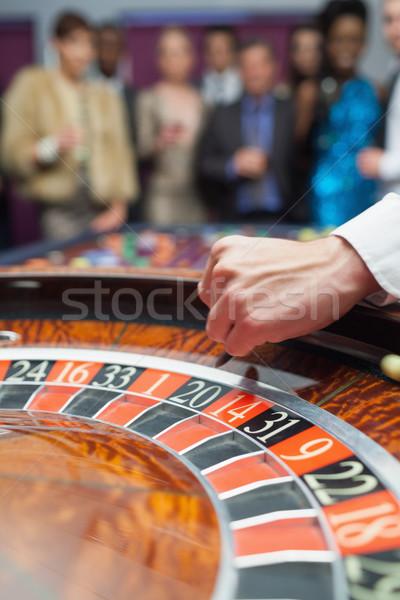 Revendedor bola roleta cassino dinheiro homem Foto stock © wavebreak_media