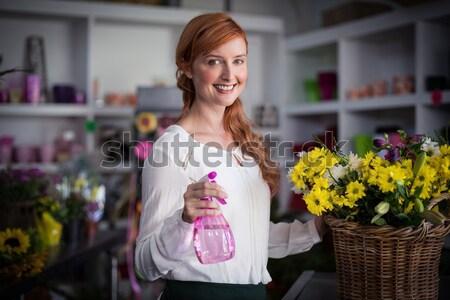 Mosolygó nő szag virágok kert központ növény Stock fotó © wavebreak_media