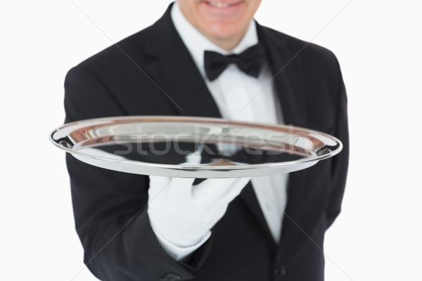Sorridente homem prata bandeja câmera Foto stock © wavebreak_media