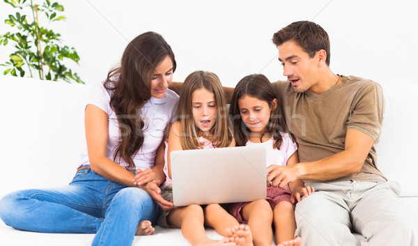 Family posing on a sofa with the laptop Stock photo © wavebreak_media