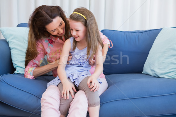 Mother and daughter on the couch Stock photo © wavebreak_media